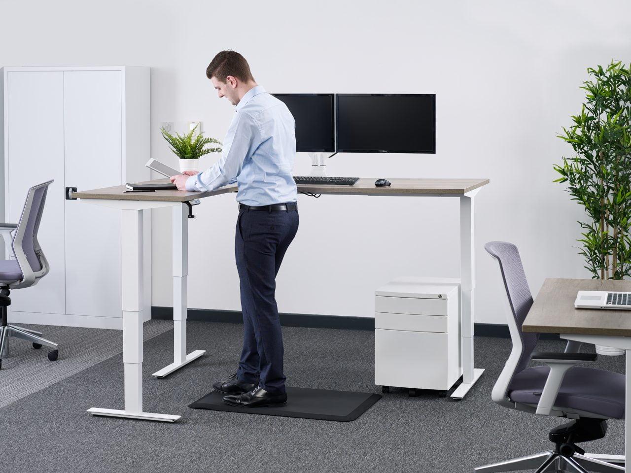 man at corner desk